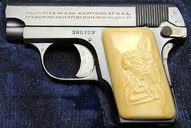 Colt Model N with Factory Carved Steerhead Ivory grips.
