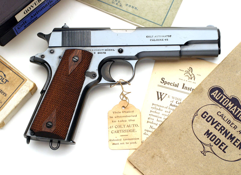 Colt Government Model in original box with accessories.